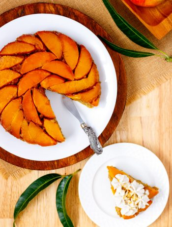 Slice of upside down mango cake eggless.